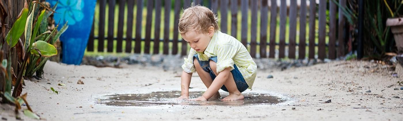 Kid playing the mud
