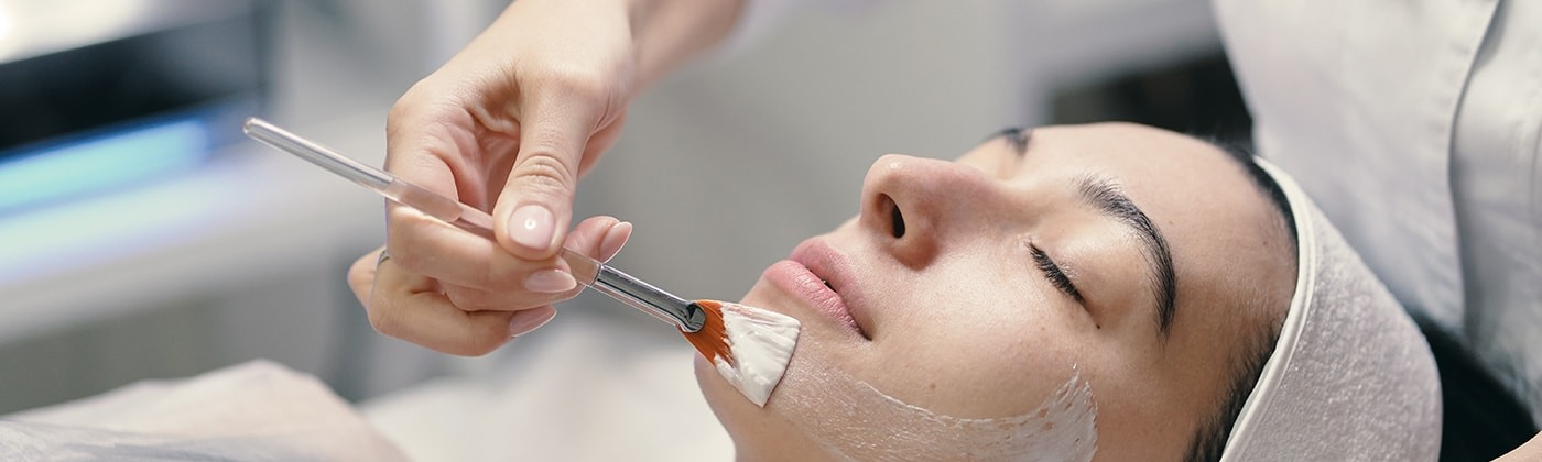 Woman seeing professional skin care doctor for acne scars