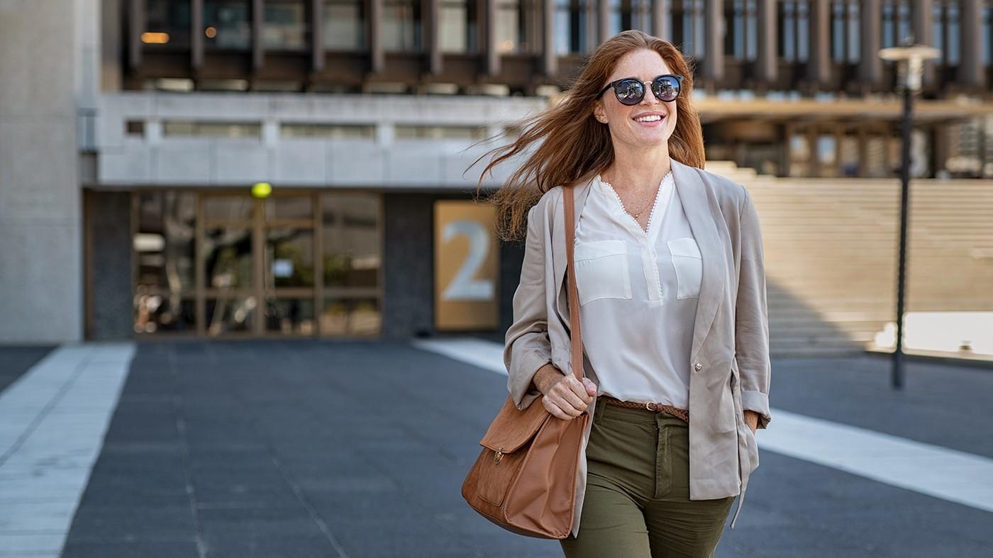 Confident woman walking outside