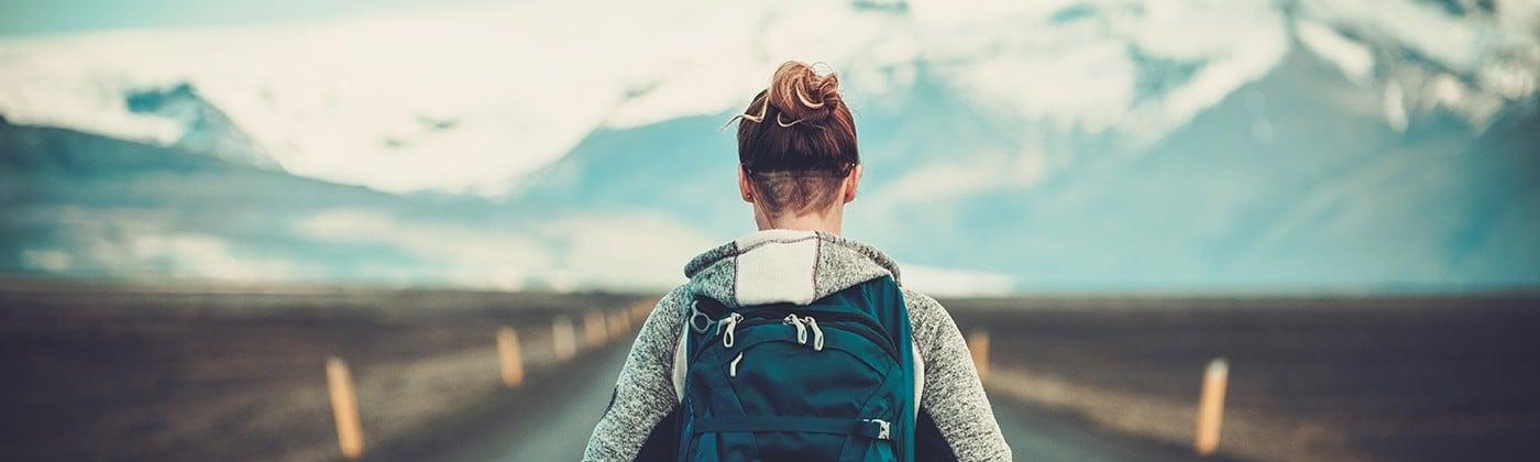 Traveler alone on empty road