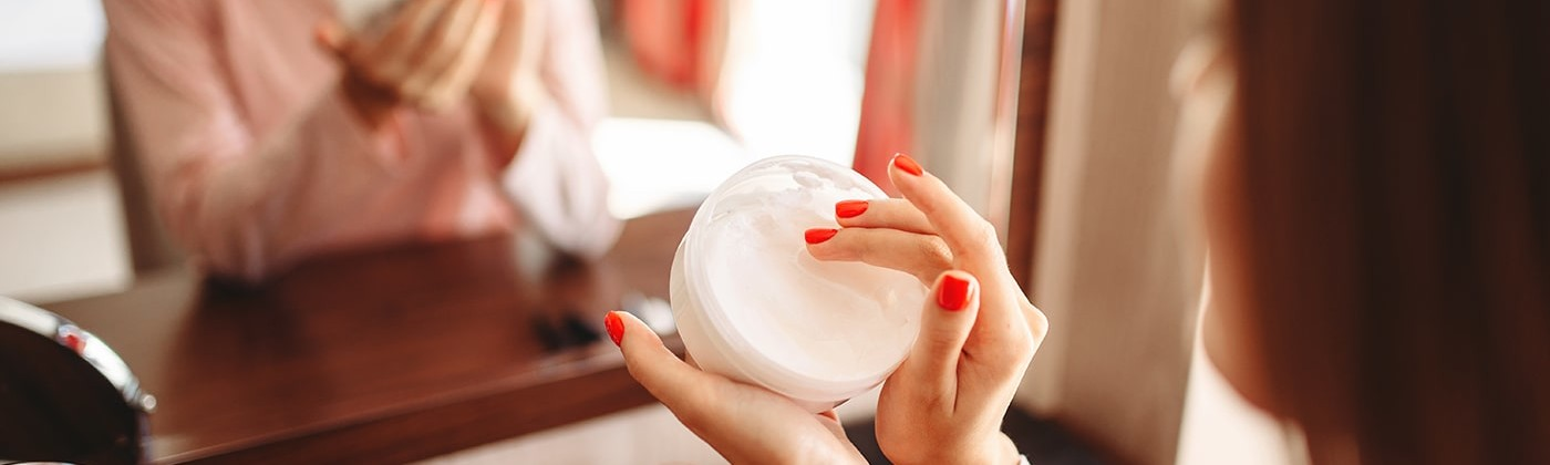 Woman using topical steroid cream