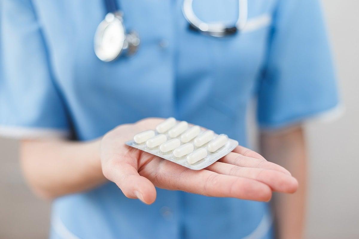 Doctor holding antibiotics