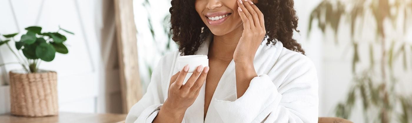 Woman applying zinc skin cream
