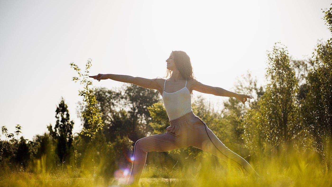 Healthy woman doing yoga outside