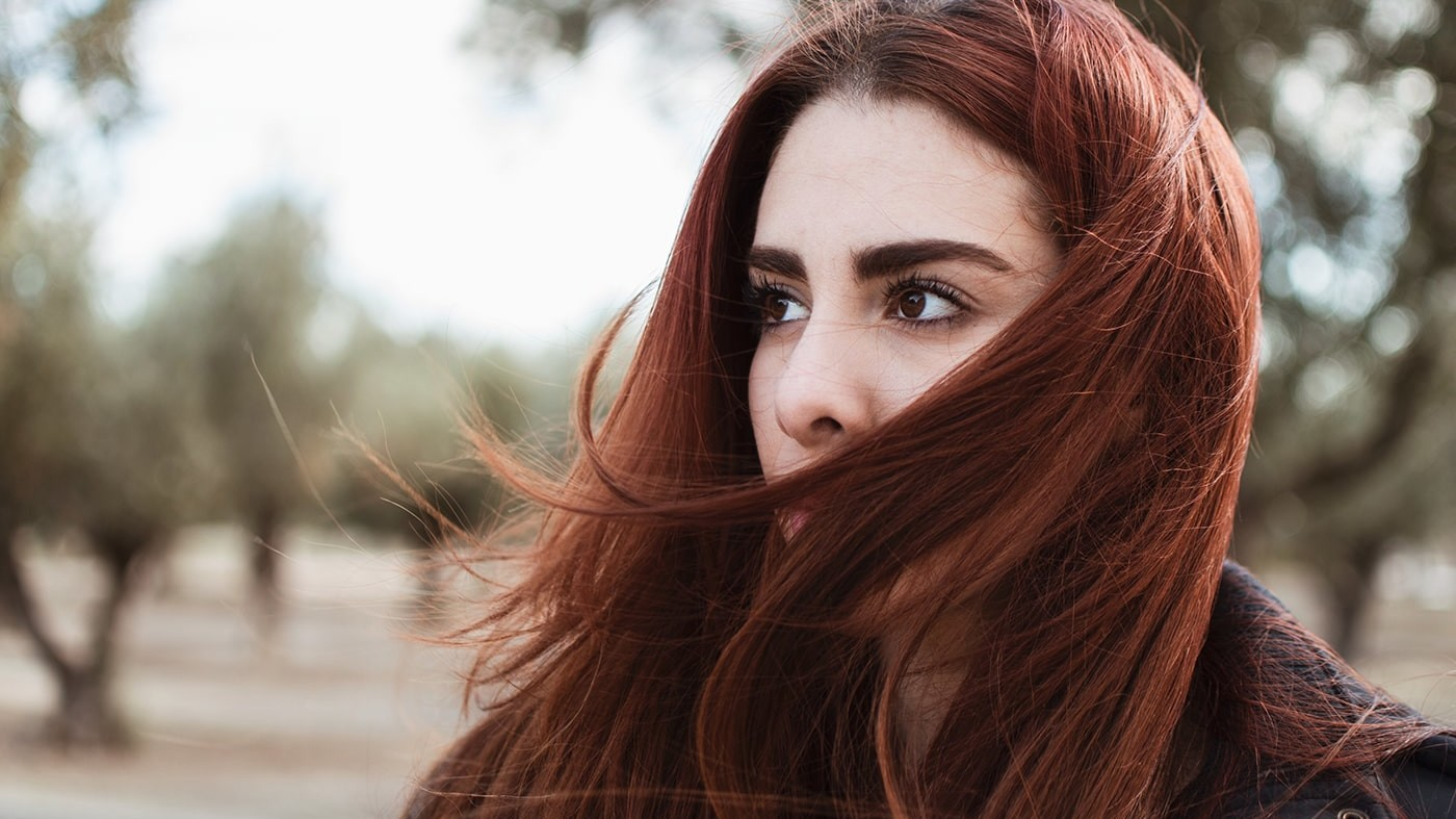 Woman thinking about where to begin with skin rashes
